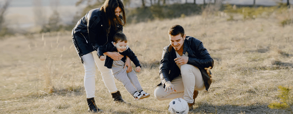 Parents playing sports with their child.