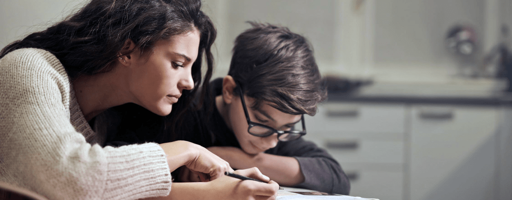 Mother and child following curriculum for homeschooling