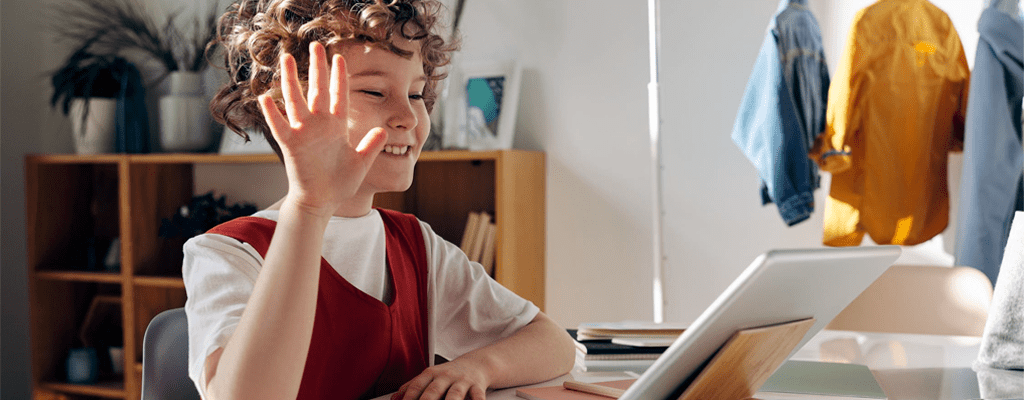 child keeping in touch with online learning friends