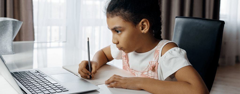 child engaging in online learning