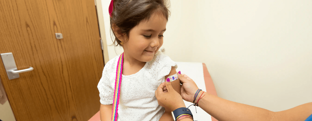child learning to administer basic first aid