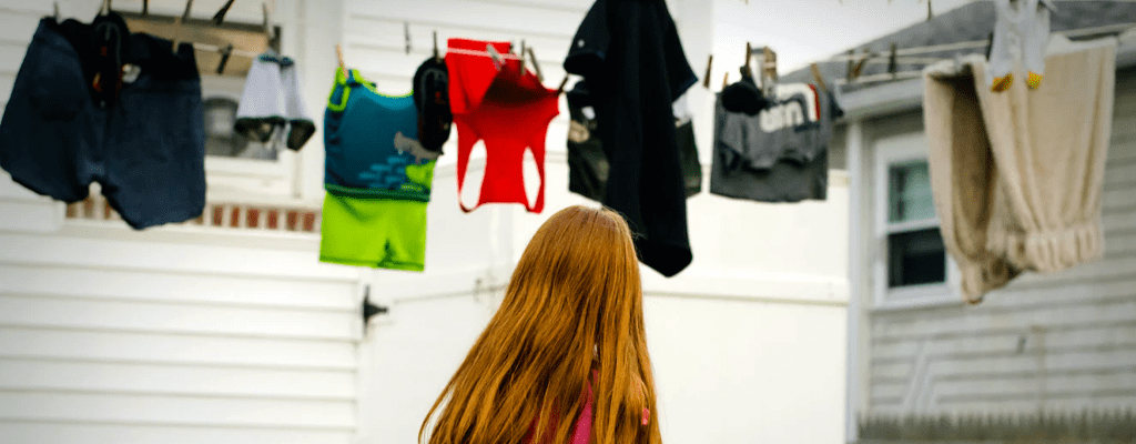 child looking at laundry