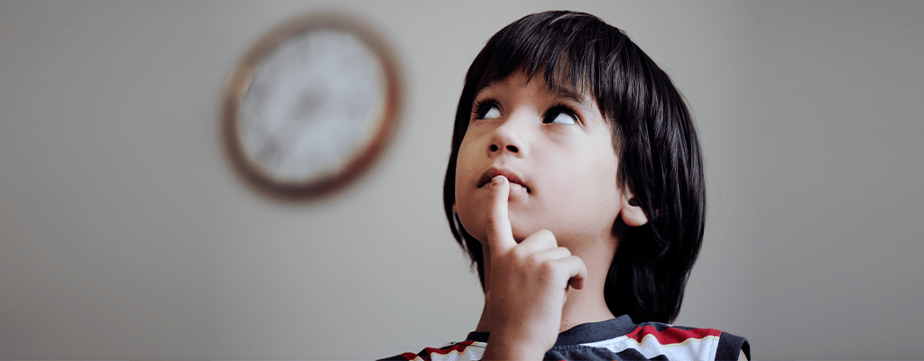 child thinking of how to spend his time