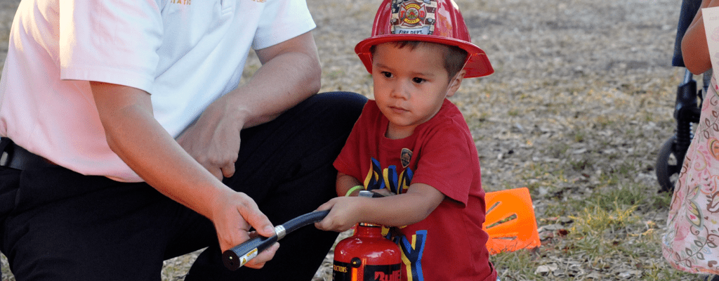 child learning to operate the fire extinguisher during quarantine