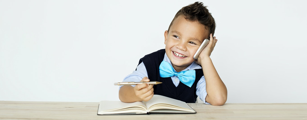 child having a conversation with his classmates through the phone