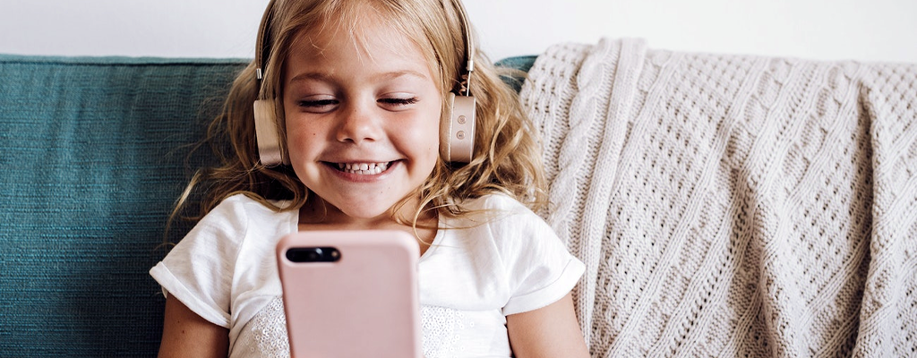 child listening to audio and word-play activities