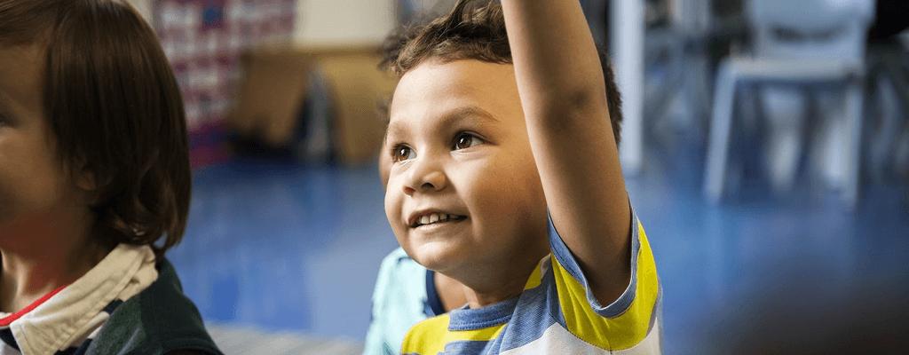 child raising his hand