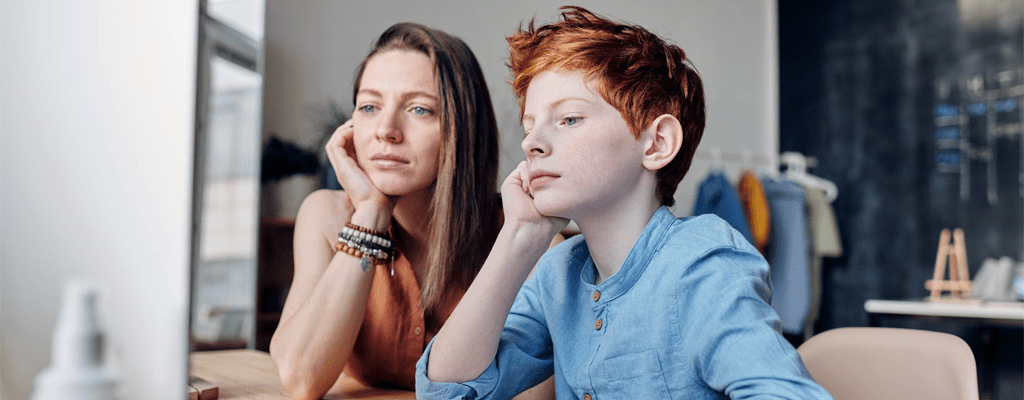 mother helping son learn with the personalized learning program