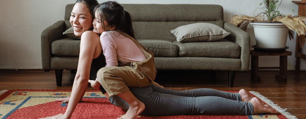 parent doing yoga with child
